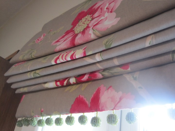 Roman blind with bobble trim