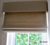 Pelmet over roman blind